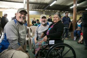 Rick and Tom fitting woman for new wheelchair